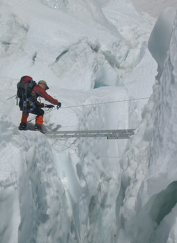 crossing a crevasse in the Khumbu icefall on Everest